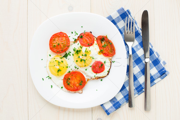 Fried egg on plate Stock photo © vankad