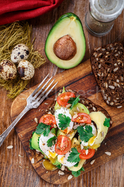 Bruschetta with tomato, avocado and quail egg Stock photo © vankad