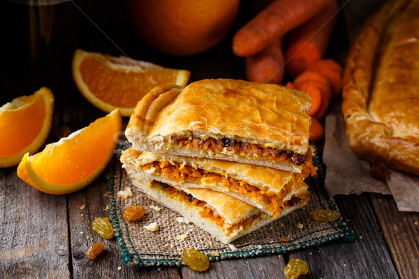 Pie stuffed with orange, carrot and raisin  Stock photo © vankad