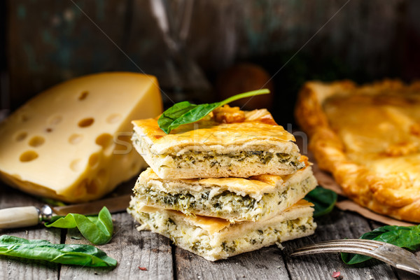 Homemade pie stuffed with cheese and spinach Stock photo © vankad