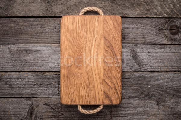 Chopping board on rustic table Stock photo © vankad
