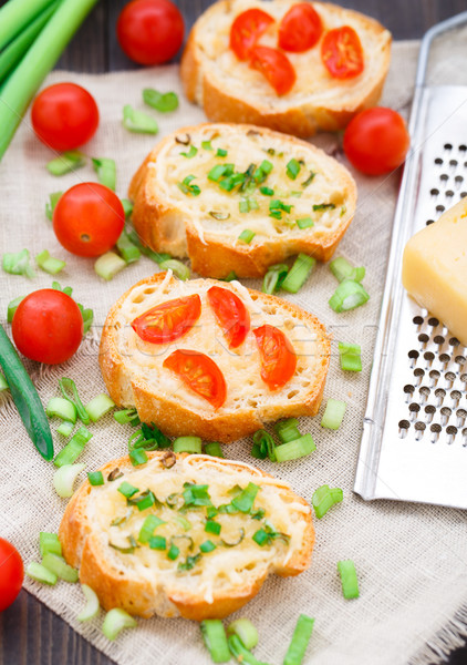 Bruschetta with cherry tomatoes and scallion Stock photo © vankad