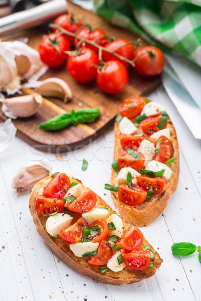 Bruschetta with cherry tomato and mozzarella Stock photo © vankad