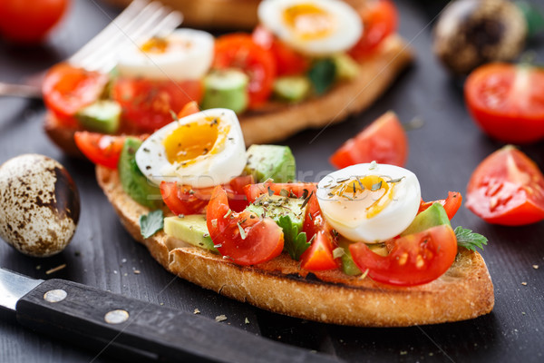 Stock photo: Bruschetta with tomato, avocado and quail egg