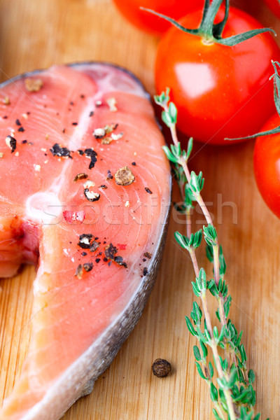 Salmon steak with thyme and pepper Stock photo © vankad