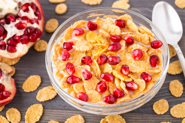 Sugar coated corn flakes with milk and pomegranate Stock photo © vankad