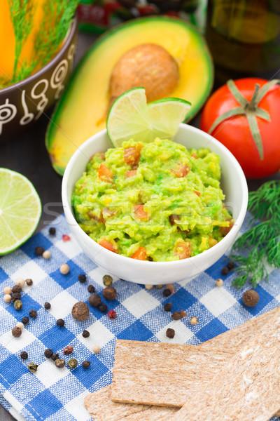 Guacamole with avocado, lime, tomato Stock photo © vankad