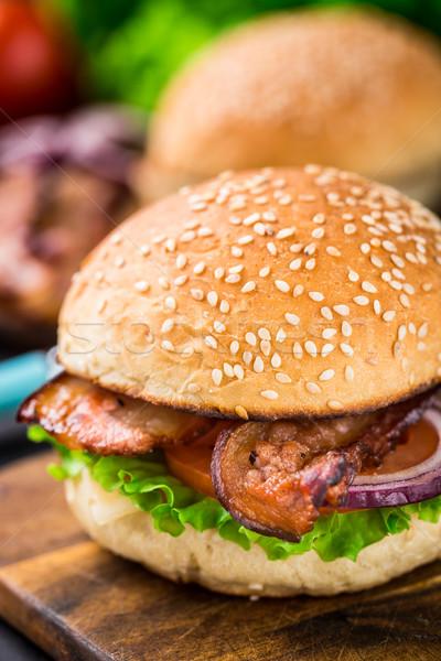 Házi hamburger fa deszka szalonna vacsora hús Stock fotó © vankad