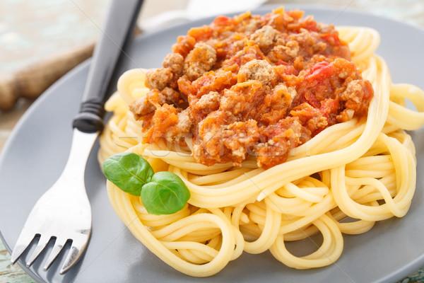 Spaghetti bolognese with basil leave Stock photo © vankad