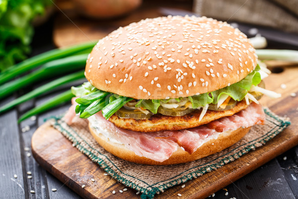 Burger with potato pancake and bacon Stock photo © vankad