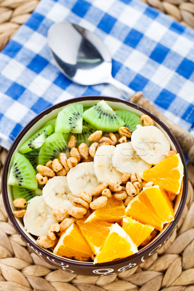 Granola with tropical fruits Stock photo © vankad