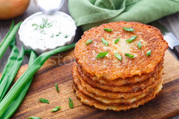 Potato pancakes on a wooden board Stock photo © vankad