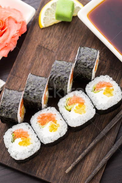 Sushi rolls with salmon and vegetables Stock photo © vankad