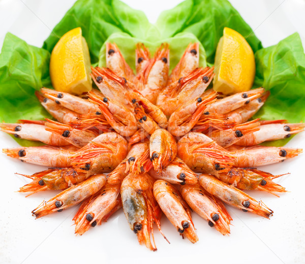 Fried shrimps on a plate Stock photo © vankad