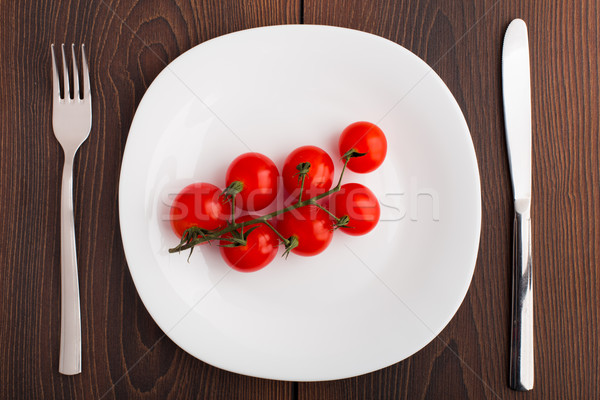 Small cherry tomato on a plate Stock photo © vankad