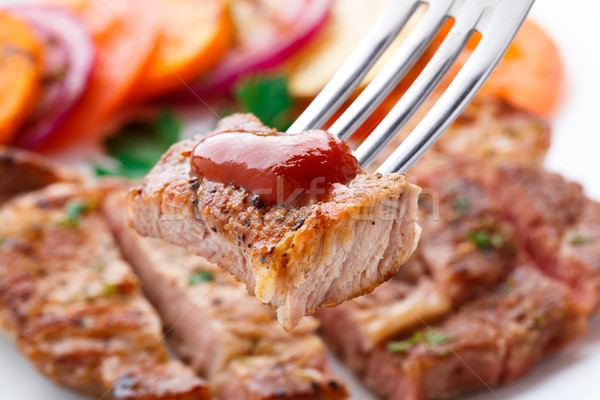 Piece of steak on fork Stock photo © vankad