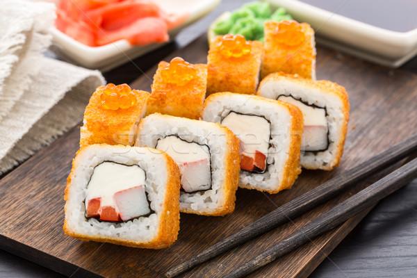Sushi rotolare gamberetti caviale crema Foto d'archivio © vankad