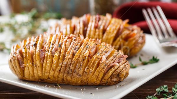 Baked hasselback potatoes  Stock photo © vankad