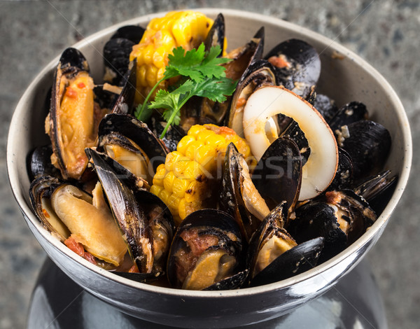 Mussels in curry cream sauce Stock photo © vankad