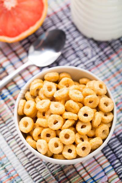 Stock photo: Bowl of honey corn rings