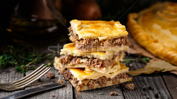 Homemade pie stuffed with beef Stock photo © vankad