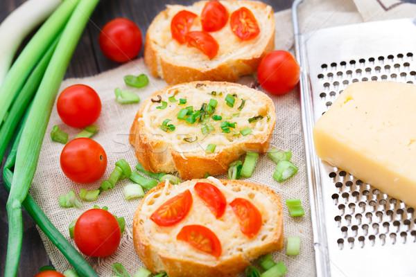 Bruschetta with cherry tomatoes and scallion Stock photo © vankad