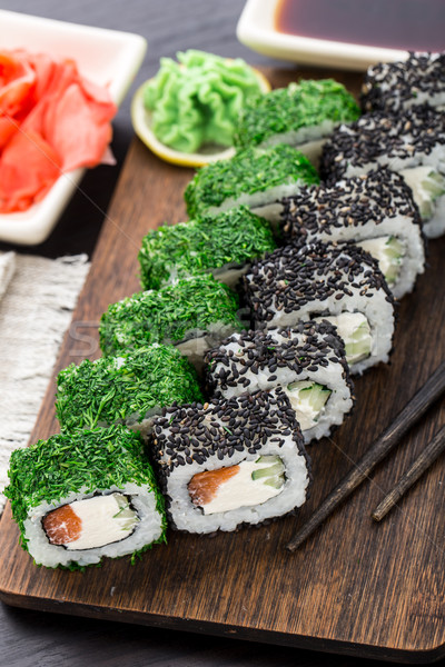 Sushi roll covered with dill and sesame Stock photo © vankad
