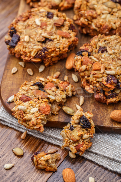 Homemade oatmeal cookies with seeds and raisin Stock photo © vankad