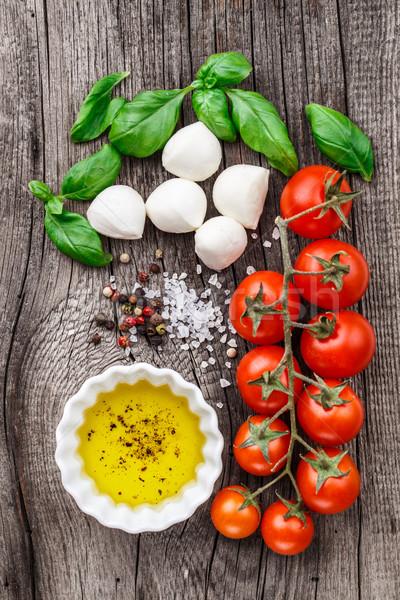 Caprese salatası malzemeler kiraz domates fesleğen yaprakları mozzarella Stok fotoğraf © vankad