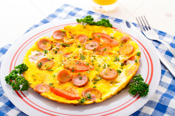 Omelette with slices of sausage and tomato Stock photo © vankad