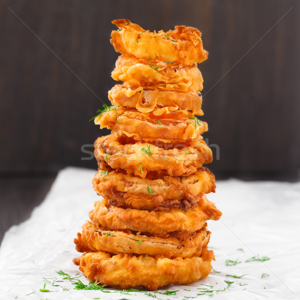 Homemade crunchy fried onion rings Stock photo © vankad