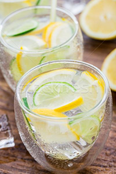 Hideg friss limonádé üveg fa asztal gyümölcs Stock fotó © vankad