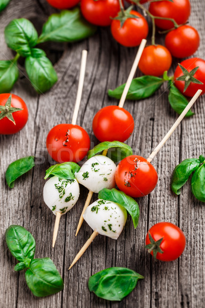 Skewers with tomato, basil and mozarella Stock photo © vankad