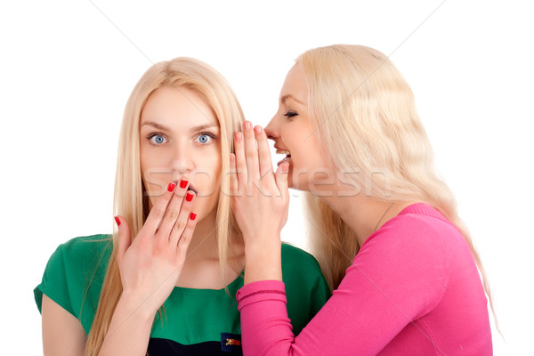 Stock photo: Two women whispering and smiling