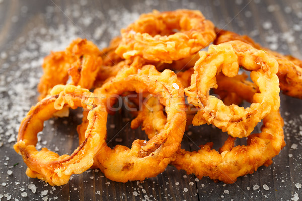 Homemade crunchy fried onion rings Stock photo © vankad