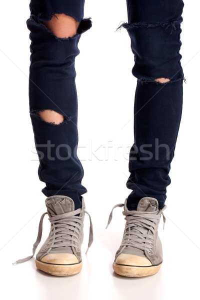 Vintage looking sneakers and ripped jeans Stock photo © vankad