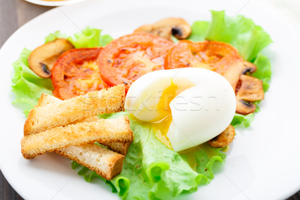 Light breakfast with soft egg, tomato and croutons Stock photo © vankad