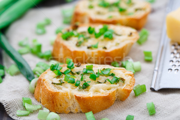Bruschetta with cheese and scallion Stock photo © vankad