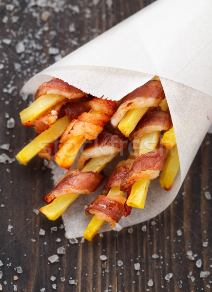 Bacon wrapped french fries Stock photo © vankad