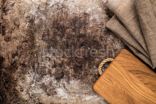 Chopping board and kitchen towel on rustic table Stock photo © vankad