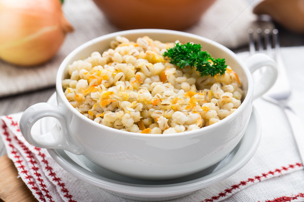 Barley porridge with carrot and onion Stock photo © vankad