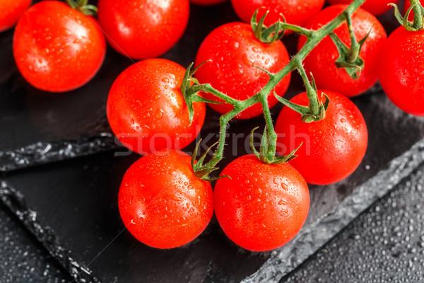 Cherry tomatoes on slate backgound Stock photo © vankad