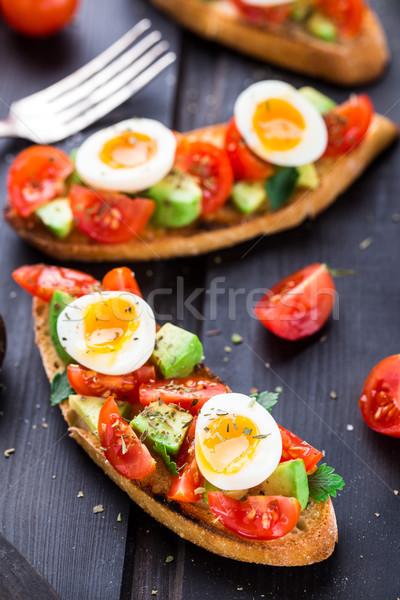 Stock photo: Bruschetta with tomato, avocado and quail egg