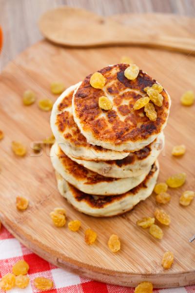 Cheese pancakes with raisins Stock photo © vankad