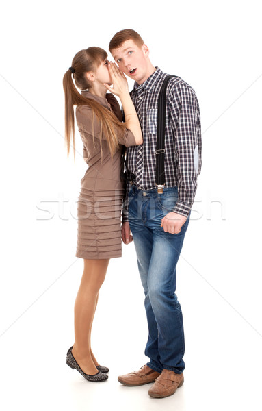 Young woman telling a secret to a man Stock photo © vankad
