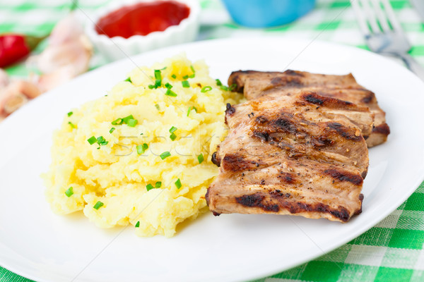 Stock photo: Grilled ribs with mashed potato