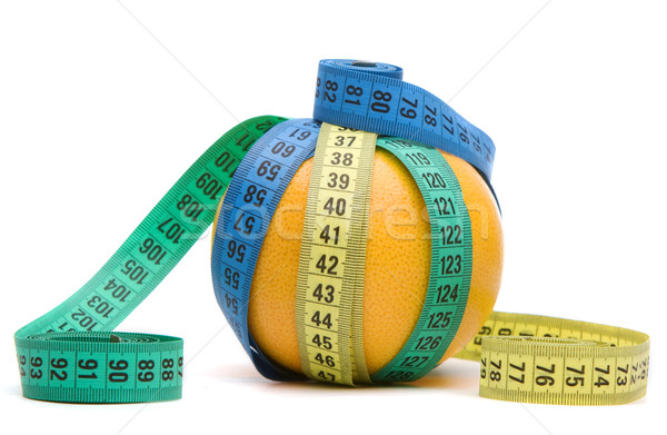 Grapefruit covered with centimeters Stock photo © vankad