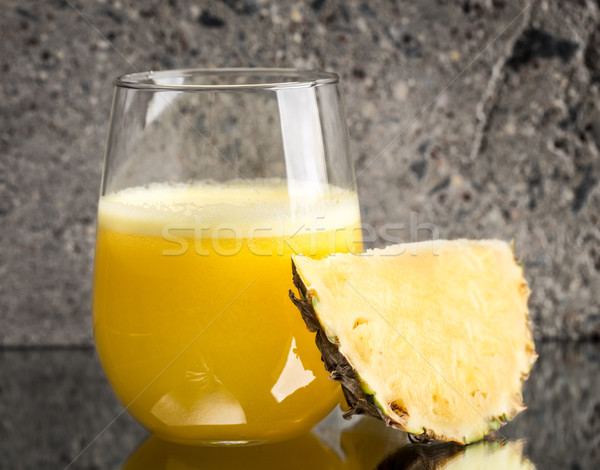 Glass of pineapple juice on concrete background Stock photo © vankad