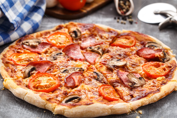 Pizza with ham and mushrooms Stock photo © vankad