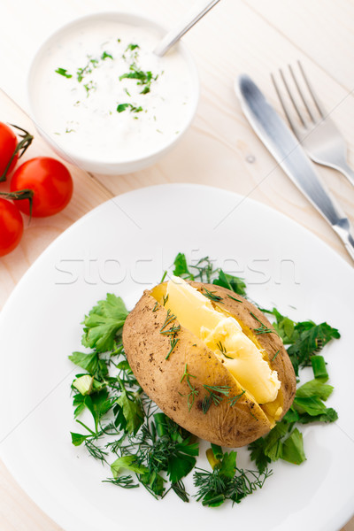 Baked potato with butter Stock photo © vankad